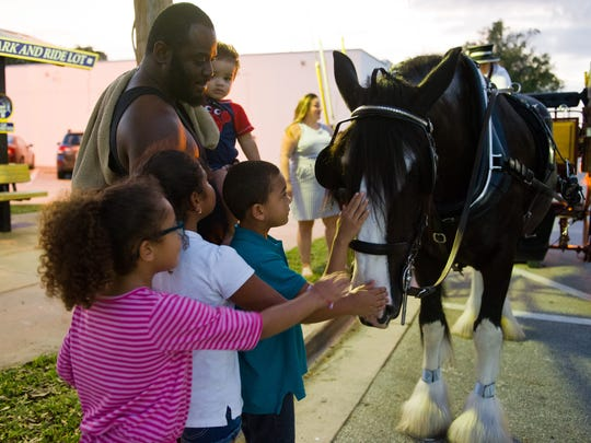 Children enjoy meeting the horses from the horse-drawn