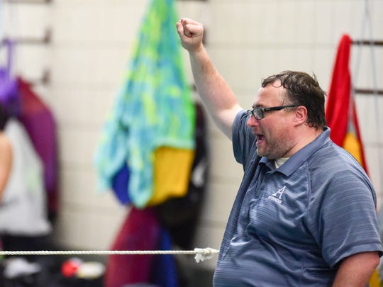 Justin Crouch cheers for a swimmer on Tuesday, Oct.11, 2016, during a girls swim meet between the Ames Little Cyclones and Ankeny Hawks at the Ankeny YMCA.