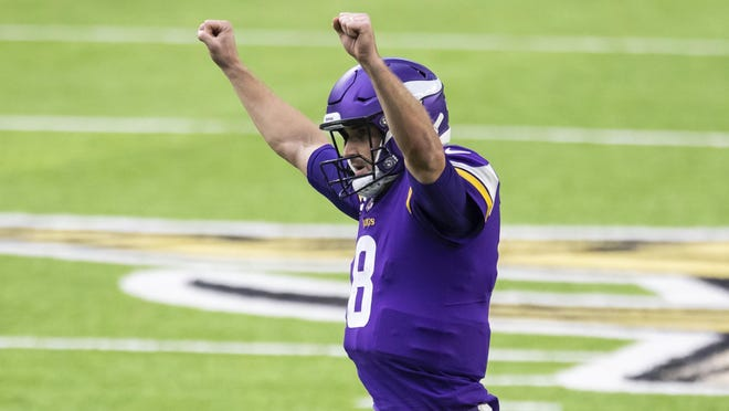 Minnesota Vikings quarterback Kirk Cousins (8) celebrates after throwing a pass for a touchdown in the third quarter during an NFL football game against the Jacksonville Jaguars, Sunday, Dec. 6, 2020, in Minneapolis. The Vikings defeated the Jaguars 27-24.