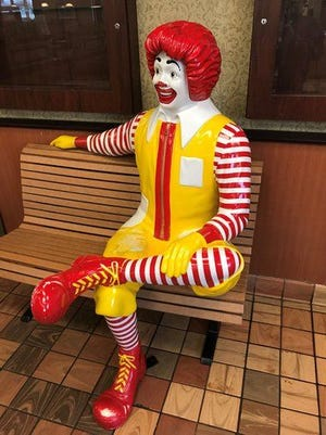 The Ronald McDonald statue sitting at the bench of the Center Street McDonald's Restaurant in Clinton before it was stolen.