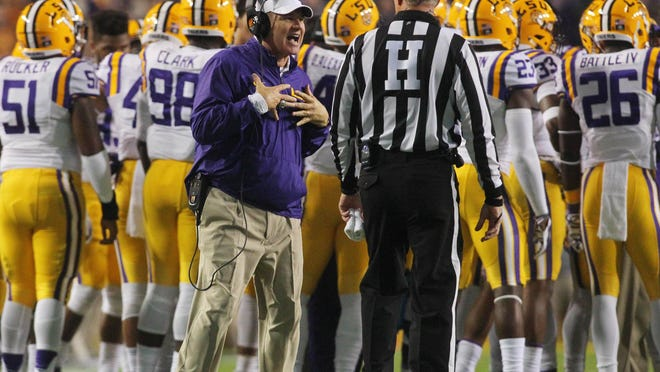 LSU Tigers head coach Les Miles argues with a referee during the first quarter at Tiger Stadium. The Razorbacks won 31-14.