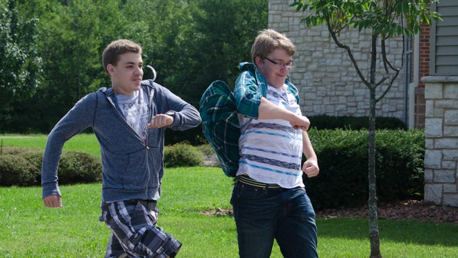 Jacob Piepenburg (left) and Ethan Wetmore march with vigor Monday during the new Wisconsin Valley Lutheran High School activity period.