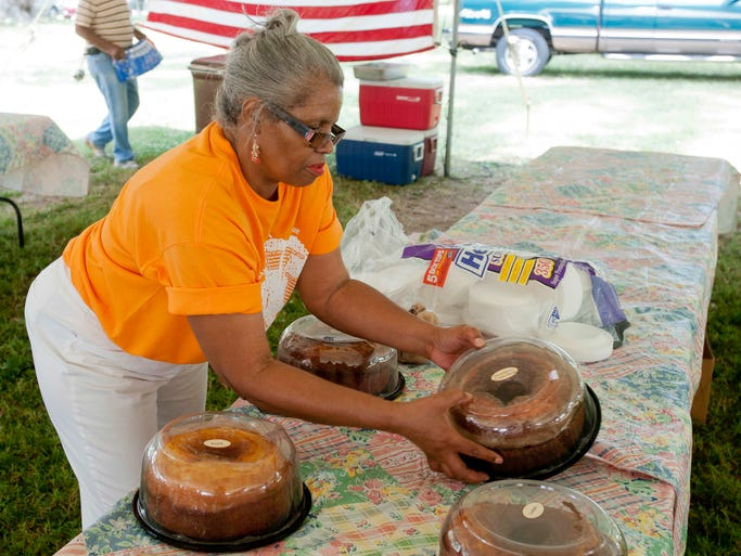 Delores Johnson of the Knox family puts deserts on the table at the Louisville Defender NewspaperÕs West Louisville Appreciation Celebration & Proud Family Reunion. 25 July 2014