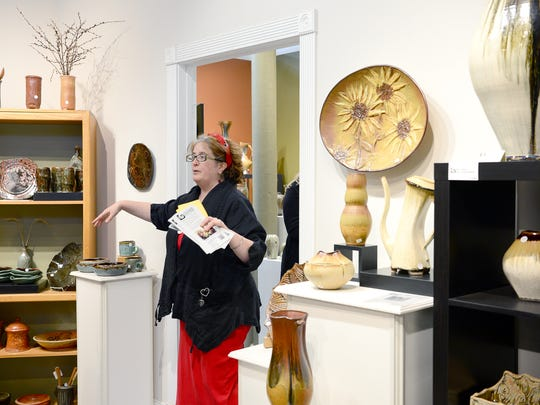 Lori Theriault gives a tour of The Village Potters studios March 8 in the River Arts District. The studio is a collaboration between several artists as well as a teaching space.