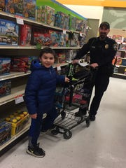 Lt. Meinnert and Mason Tepiew at Shopko in Manitowoc during the Two Rivers Police Department's Shop with a Cop event.