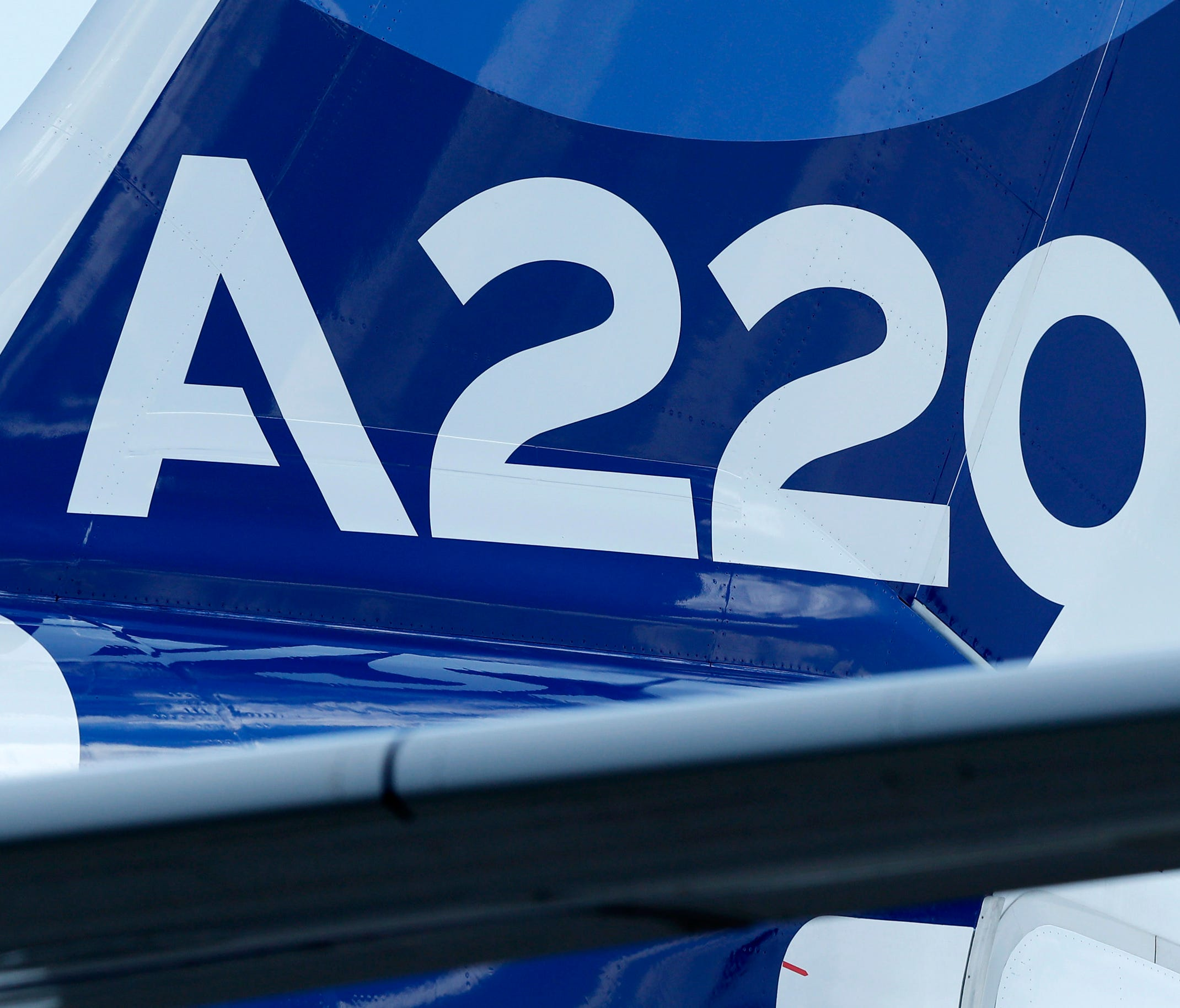 The tail rudder of a new Airbus A220-300 aircraft during the presentation of the new Airbus A220-300 at Airbus's delivery center in Toulouse, France, on July 10 July 2018.