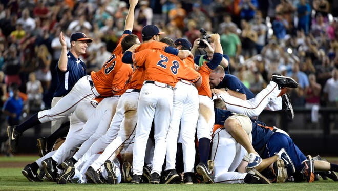 Virginia players celebrate beating Vanderbilt 4-2 in Game 3 of the best-of-three College World Series finals at TD Ameritrade Park in Omaha, Neb., Wednesday.
