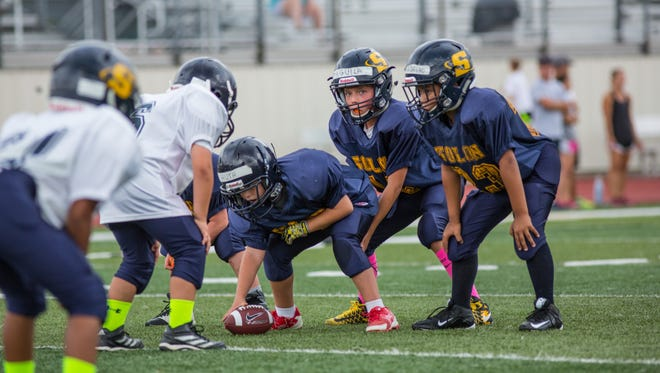 USA Football is unveiling a pilot program Wednesday in 11 organizations around the country that features fewer players, smaller fields, no special teams and no three-point stances.