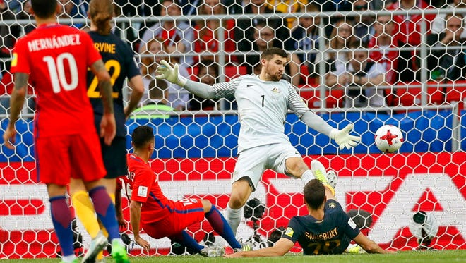 Martin Rodriguez of Chile scores the equalizer in a 1-1 tie against Australia at the Confederations Cup.