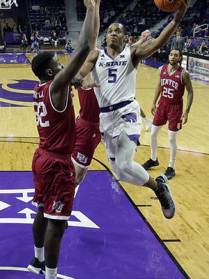 Kansas State's Barry Brown Jr. puts up a shot over Denver's Abiola Akintola (32) during the second half of an NCAA college basketball game Monday, Nov. 12, 2018, in Manhattan, Kan. Kansas State won 64-56. (AP Photo/Charlie Riedel)