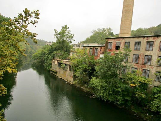 Bancroft Mills depicted before a fire and condo development encroached on the historic mill.