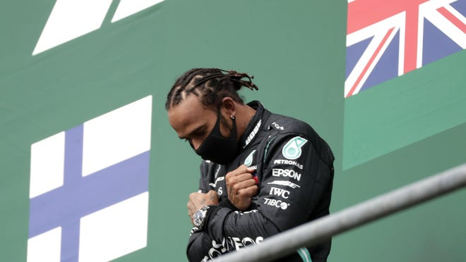 Mercedes driver Lewis Hamilton of Britain celebrates on the podium Sunday after winning the Formula One Grand Prix in Belgium.