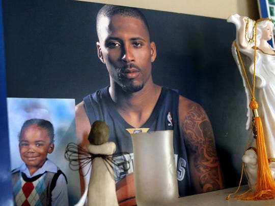 Photos of Lorenzen Wright displayed in the home of