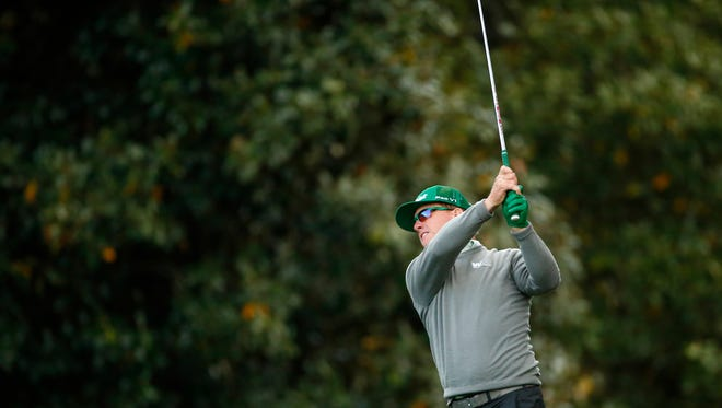 Charley Hoffman plays his second shot on the 18th hole during the first round of the Masters on April 6.