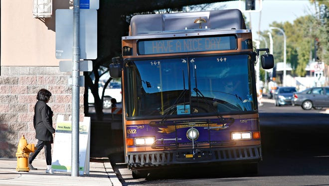 A rider boards the free trolley at Scottsdale Fashion Square that runs between the shopping mall and Scottsdale Community College on Nov. 5, 2015.