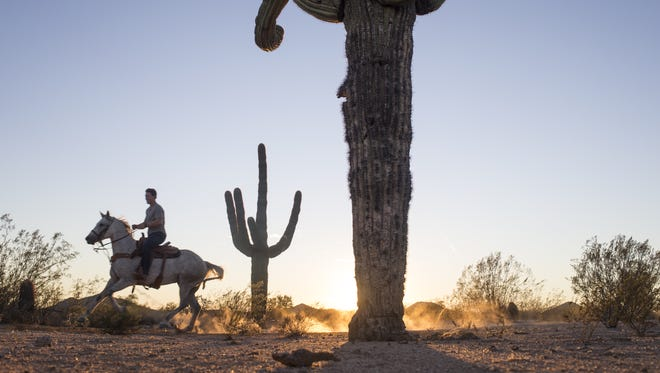 Shane Doan rides his horse, RJ, in the desert, September 29, 2016, near Ice Barns, Cave Creek, Arizona.