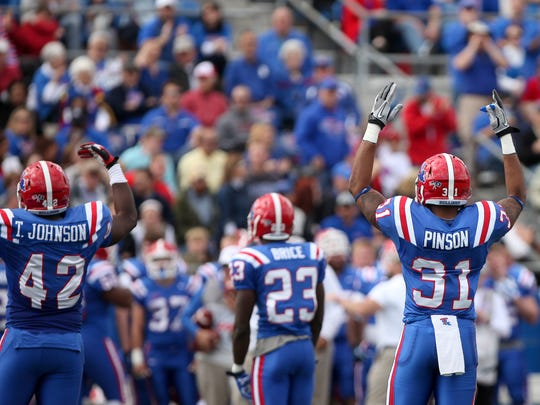 Louisiana Tech players react during a 2014 win over Rice. The Bulldogs scored 42 unanswered points in an easy 76-31 victory.