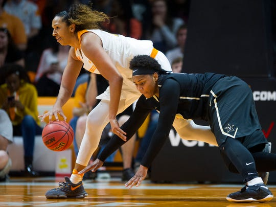 Tennessee's Mercedes Russell tries to protect the ball from Vanderbilt's Marqu'es Webb at Thompson-Boling Arena on Sunday, January 22, 2017.