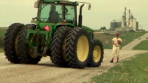 """""""The Daily Show with Jon Stewart"""" correspondent Al Madrigal hitches a ride on a tractor during a recent visit to Iowa."""