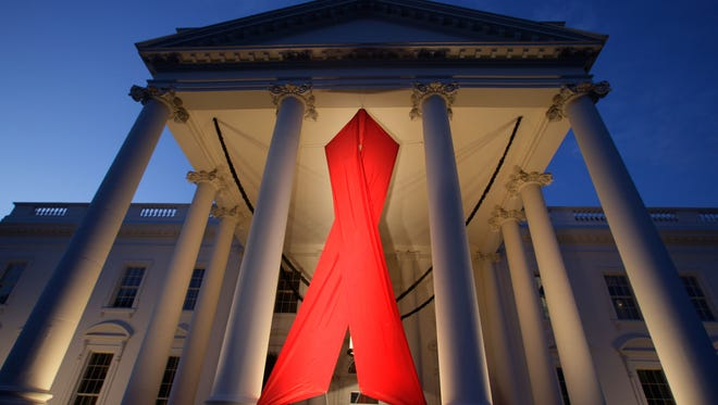 A large AIDS ribbon hangs from the North Portico of the White House in Washington in 2007, in honor of World AIDS Day, which is officially marked around the world on Dec. 1.