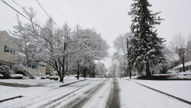 Campbell road in Binghamton was blanketed in snow and ice Tuesday morning.