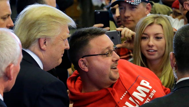 Republican presidential candidate Donald Trump poses for a photo with a supporter after speaking at a campaign rally, Friday, April 15, in Plattsburgh, N.Y.