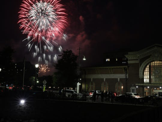 Fireworks light the sky over the Hudson River in Yonkers, next to the historic 1911 Beaux-Arts style railroad station building, July 4, 2018.