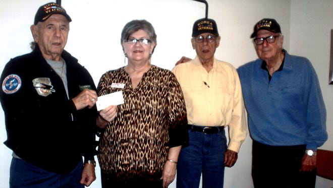 Mountain Home chapter 22 of the Korean War Veterans presented a $1,000 donation to Kindness, Inc. Shown are Alex Oliz, KWV Chapter 22 treasurer, from left, Debbie Wamock, Kindness, Inc., executive director, Jess Milford, Chapter 22 president, Clark Webster, Kindness volunteer and Chapter 22 member.