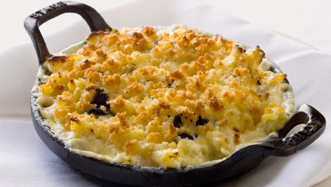 How could mac 'n' cheese get any sexier? Add black truffles. This macaroni and cheese was served at a special five-course Italian dinner at The Capital Grille.