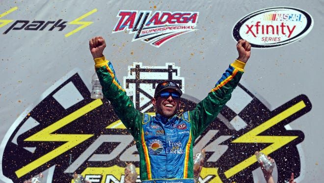 Aric Almirola celebrates after winning the Sparks Energy 300, Saturday at Talladega Superspeedway.