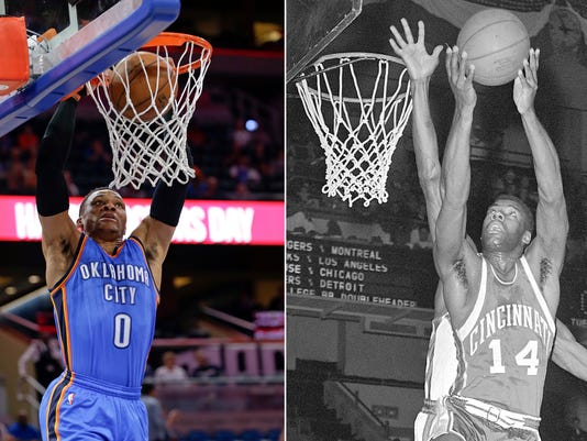 FILE - At left, in a March 29, 2017, file photo, Oklahoma City Thunder's Russell Westbrook makes an uncontested dunk against the Orlando Magic during the first half of an NBA basketball game, in Orlando, Fla. At right, in a Feb. 3, 1962, file photo, Cincinnati guard Oscar Robertson goes to the basket against the New York Knicks, in New York. Oklahoma City Thunder guard Russell Westbrook is one triple-double away from matching Oscar Robertson's single-season record. (AP Photo/File)