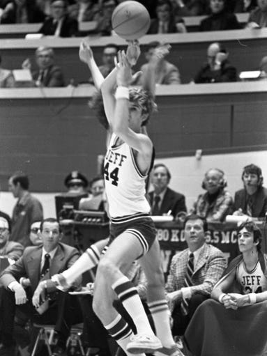 Jefferson High School's Bronchos had trouble against Fort Wayne Northrop's pressing defense during the IHSAA finals in Bloomington, ofren needing 'big men' to take the long passes at mid-court while binring the ball up-floor. Above, Jeff scoring leader Gene Bowen is challenged by a Bruin player, mostly obscured behind Bowen, on one of those long passes. Photo taken March 24, 1974.