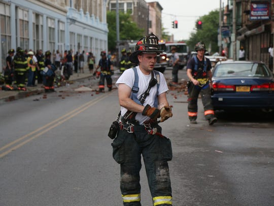 Scenes from the building collapse on Academy Street