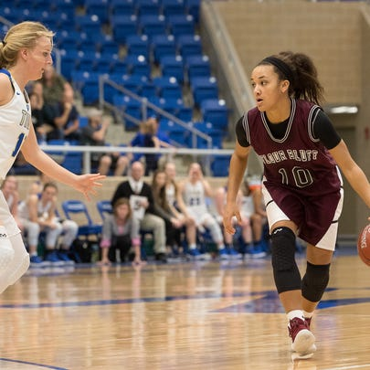 Flour Bluff's Hayle Campbell drives the ball past Kerrville's