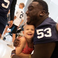 Penn State players give Hershey hospital kids a football lift