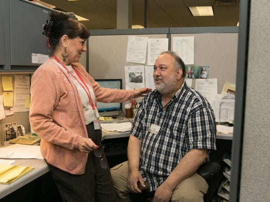 Mark Stolzer talks with a co-worker, Maxine Feintuch. Mark has been living with schizophrenia since 1976 after a serious head injury, he was photographed at his work place in Piscataway, NJ, April 6, 2016.