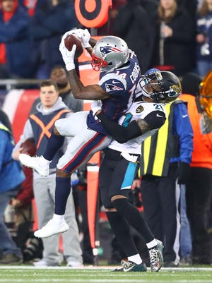 New England Patriots wide receiver Brandin Cooks (14) catches a pass against Jacksonville Jaguars cornerback A.J. Bouye (21) during the AFC Championship at Gillette Stadium.