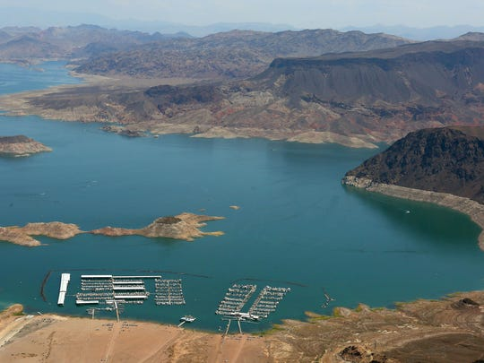 "Declining water levels in Lake Mead are evident from the white ""bathtub ring"" around the lake, which shows how high the water used to be."