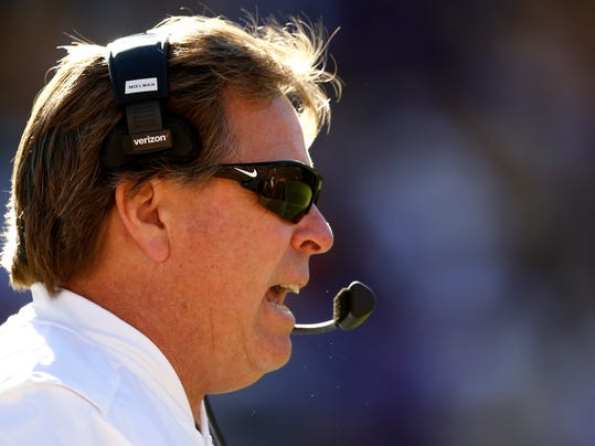 FILE - This Nov. 19, 2016 file photo shows Florida head coach Jim McElwain watching from the sideline in the second half an NCAA college football game against LSU in Baton Rouge, La. McElwain made Southeastern Conference history by becoming the first coach to reach the league's championship game in his first two seasons. (AP Photo/Gerald Herbert, file)
