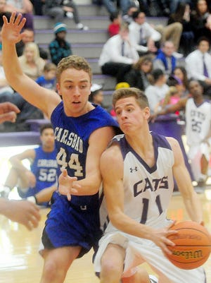 Carlsbad junior Gage Shoup guards a driving Clovis senior Luke Bussen in the first half of Tuesday's district game at Rock Staubus Gymnasium.