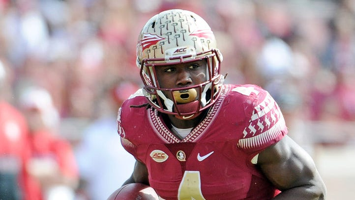"""Florida State running back Dalvin Cook rushes against North Carolina State in their game last season. He said the Seminoles are """"gonna be ready"""" to face Ole Miss in their season opener Sept. 5 in Orlando, Florida."""