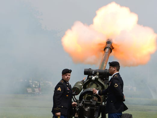 The 2-218th Field Artillery performs the Howitzer salute during the Armed Forces Day ceremony at the Oregon State Capitol on Thursday, May 15, 2014.