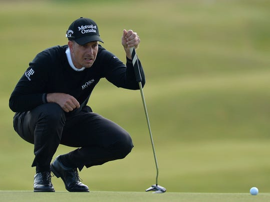 Henrick Stenson of Sweden looks over his putt at the 5th hole during day one of the  Scottish Open at Dundonald Links, Troon, Scotland Thursday July 13, 2017. (Mark Runnacles/PA via AP)
