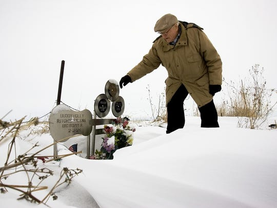 "Former Mason City Globe Gazette photographer Elwin Musser at the site of the 1959 plane crash near Clear Lake, Iowa, that killed musicians Buddy Holly, Ritchie Valens, J.P. ""The Big Bopper"" Richardson Jr. and pilot Roger Peterson."