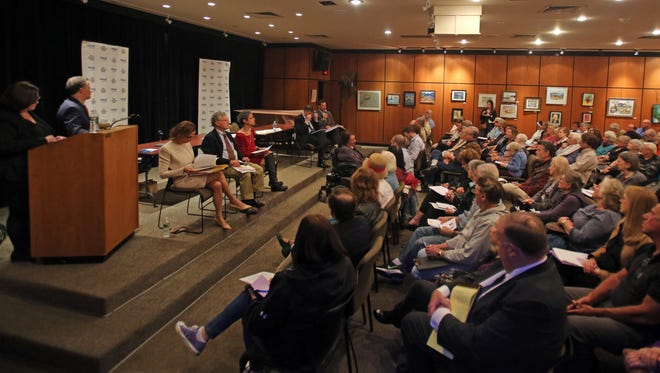 "People packed Scarsdale Public Library on April 25 to hear a Journal News debate on whether New York state should have ""aid in dying"" legislation."