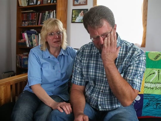Darrel and Christine Harken of Riceville become emotional while talking about their daughter Grace, who was killed when her bicycle was struck by a driver who was texting on a road near Osage last July.