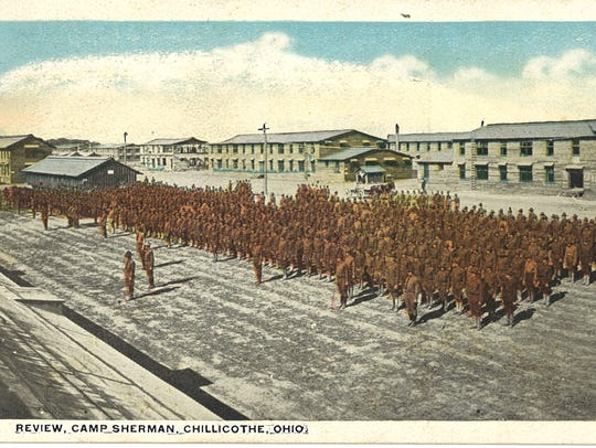 This postcard shows a troop review at Camp Sherman
