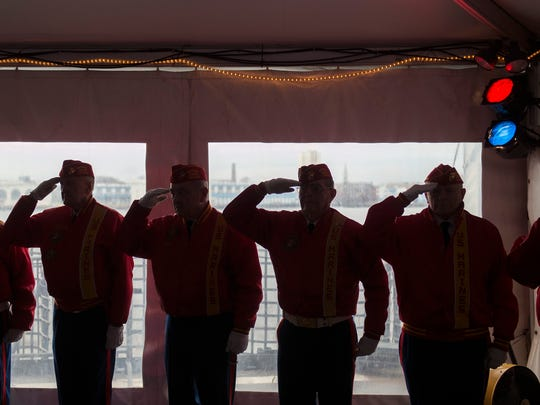Members of the Marine Corps League based in Somerdale salute during a pledge of allegiance aboard the USS New Jersey Tuesday, Dec. 5, 2017 in Camden, New Jersey. A ceremony was held for the 76th anniversary of the attack at Pearl Harbor.