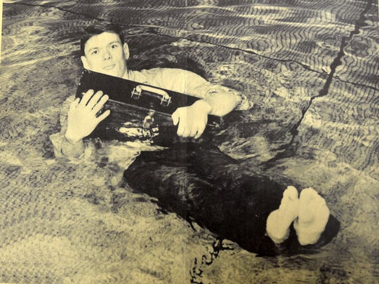 This 1950s-era photograph demonstrated the Tronick Tackler's role as a life preserver.