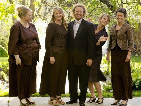 AP SISTER WIVES LAWSUIT A FILE USA